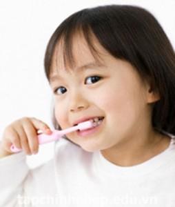 Young Girl Brushing Teeth
